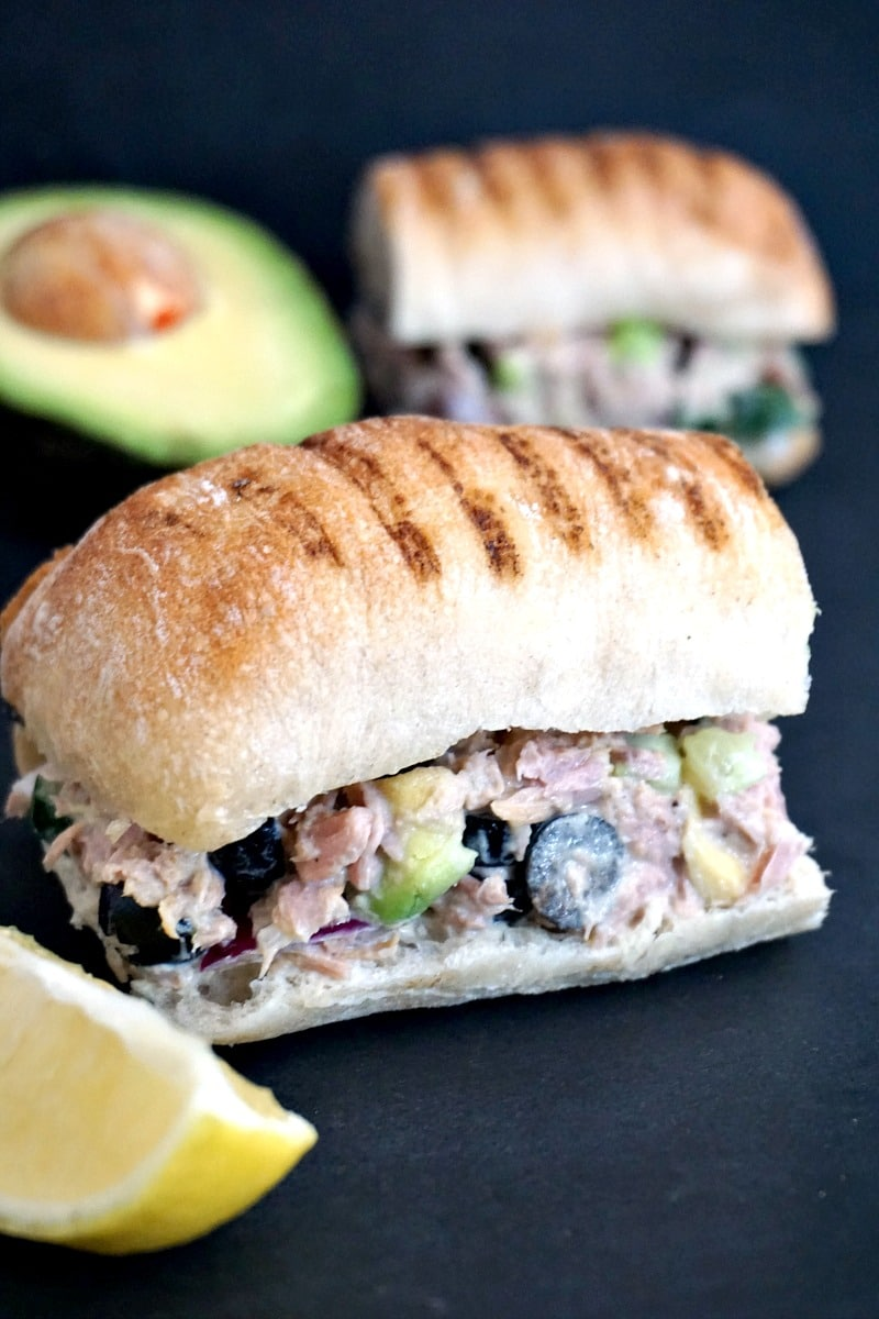 Easy tuna salad sandwich recipe with avocados, black olives and cucumber, healthy, filling and so delicious.