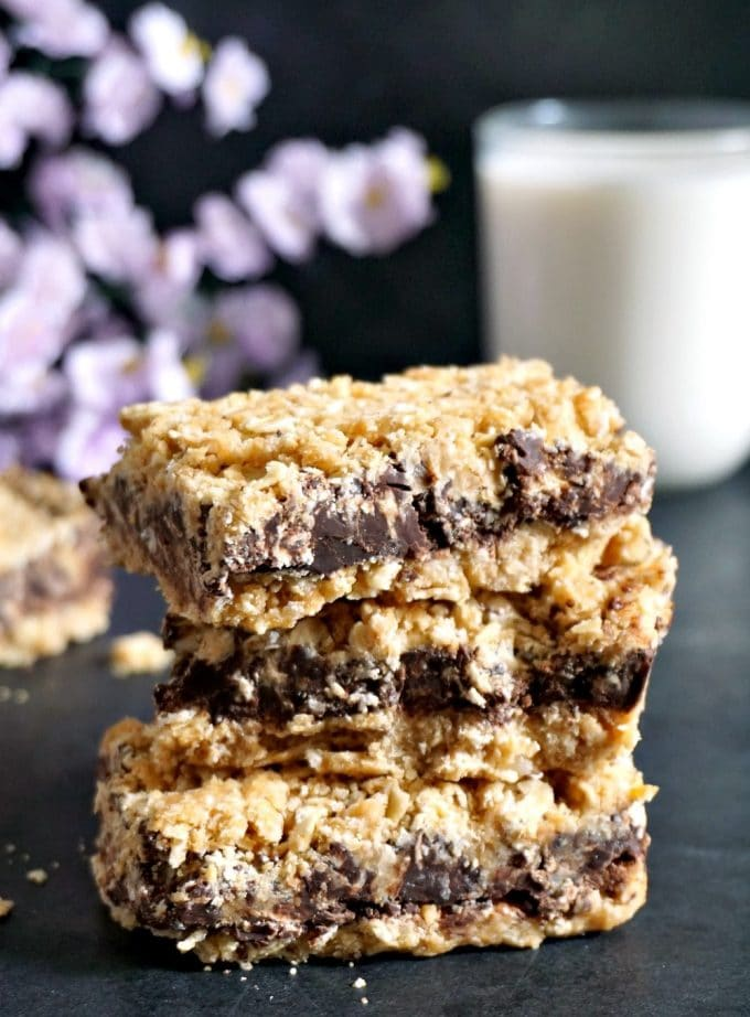 A stack of 3 no-bake chocolate oat bars