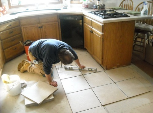 kitchen tile floor cupboard organization gig harbor installation photo gallery from handyman mike