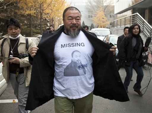 https://i0.wp.com/www.myhero.com/images/AP_Story/Into/g47_u98705_Ai_weiwei_opens_jacket.jpg