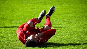 personal injury chiropractor in west palm beach treats sport injuries soccer player hurt on field