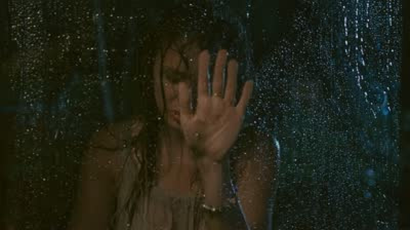 stock-footage-sad-woman-in-the-rain