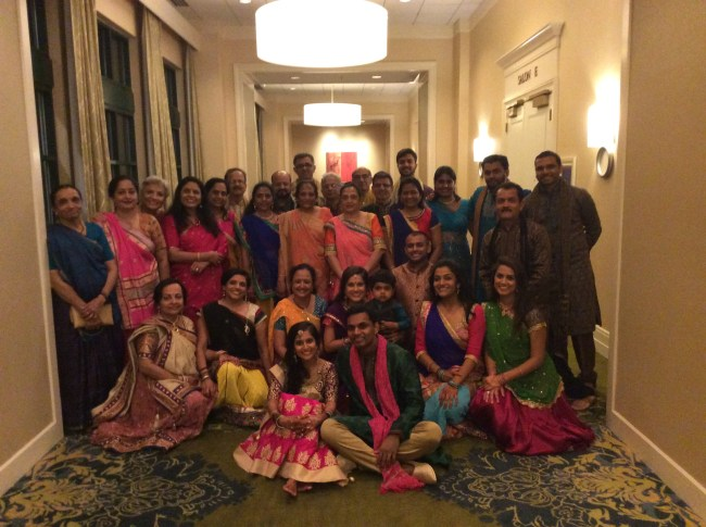 Family photo at Indian wedding garba program