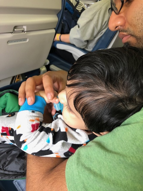 Baby on airplane with dad