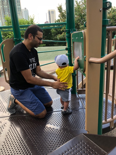 baby and his dad at the playground chicago