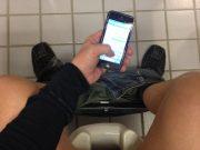 man-texting-on-toilet