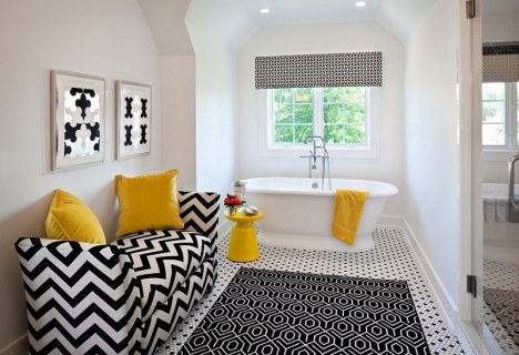 Yellow is a bold accent color in a black and white bath.