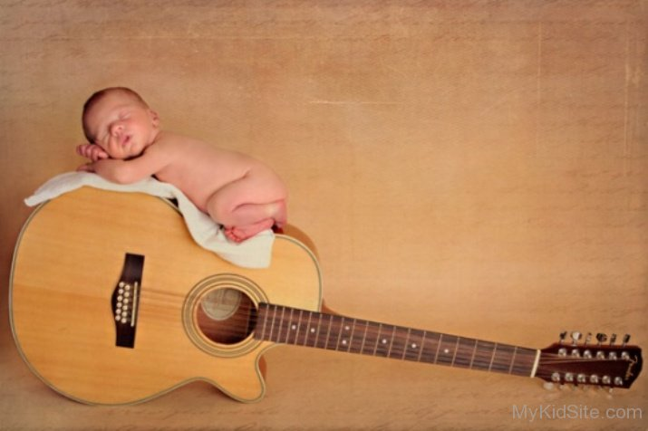Cute Girl Smiling Wallpaper Cute Baby Sleeping On Guitar