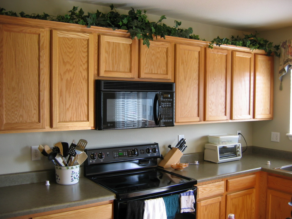 greenery above kitchen cabinets pantry storage units tips decorating - my ...