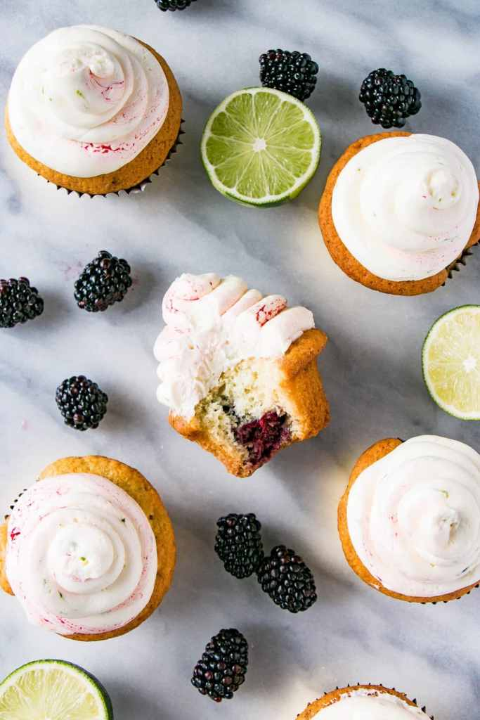Blackberry Lime Cupcakes with a bite taken out.