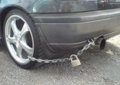 car tire with chain and padlock