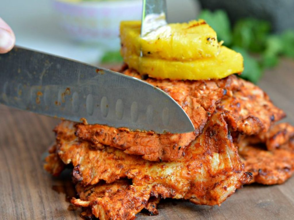 Tacos al Pastor - made with slow marinated pork, grilled to perfection, and served with grilled pineapple.