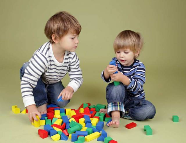 Young boys building blocks