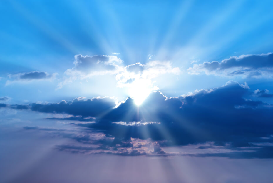 Beautiful blue sky with sunbeams and clouds