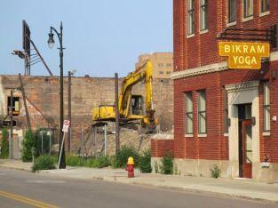 Yoga shop abuts demolition site.