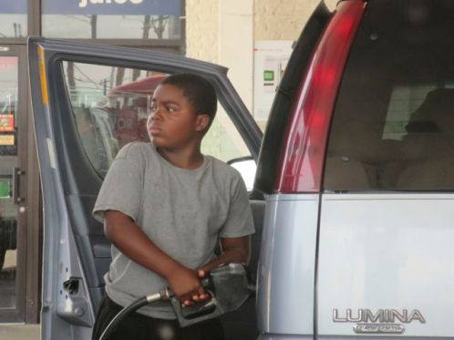 Ten-year-old pumps his own gas.