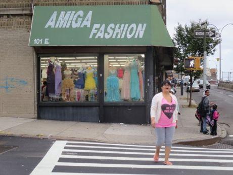 "Lady wearing shirt reading ""Heart Breakers"" passes Amiga Fasion."