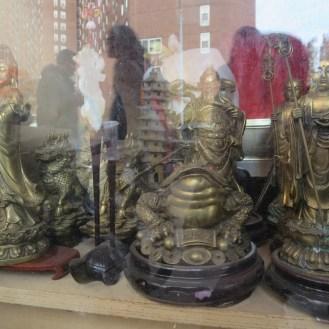Religious iconography for sale next door.