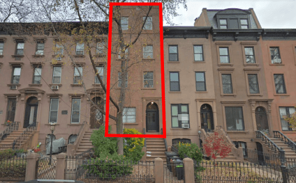 303 President Street, Carroll Gardens: The brownstone in center used to resemble its neighbors but was modified before the neighborhood was transformed into a historic district in 1973.
