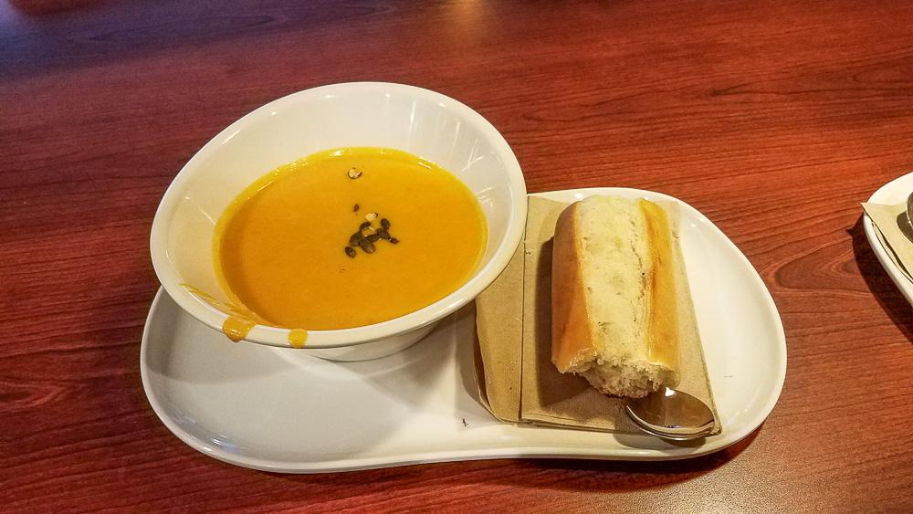 Panera Bread Autumn Squash Soup with baguette