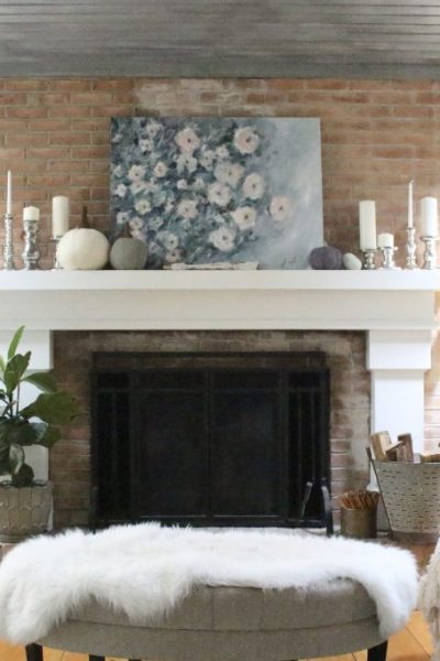 Using pastel colors to decorate for fall- fall decor- nontraditional colors- decorating with pastels- seasonal decor- home interior- mantel- pale colors- neutral decor- decorated mantel- mantle