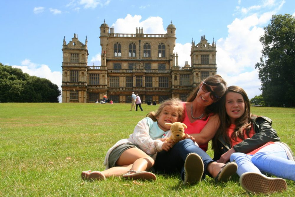 Family in front of Wollaton Hall, an Elizabethan Hall in Nottingham. Inside is filled with alsorts of Zoological, Geological and Botanical gems