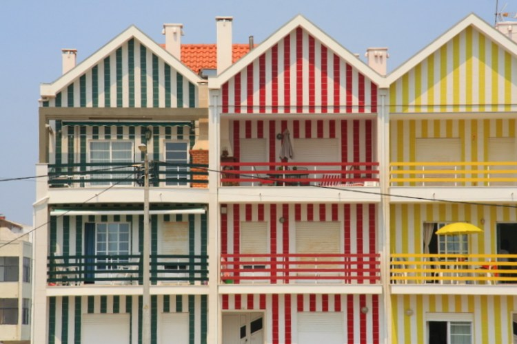Striped Beach Houses of Costa Nova, Portugal - a little seaside town on the West coast with great beaches and some fantastic restaurants. The colourful houses really make this a highlight for this area - a portugal bucket list place