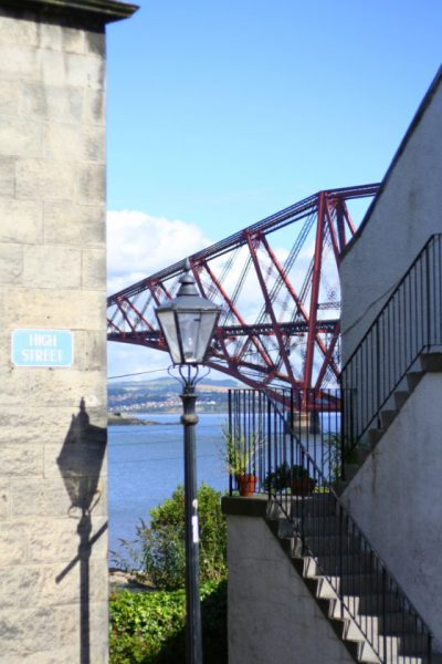 Peeks of the Forth Rail Bridge in South Queensferry can be seen through the gaps in the pretty fishermans cottages along the High Street