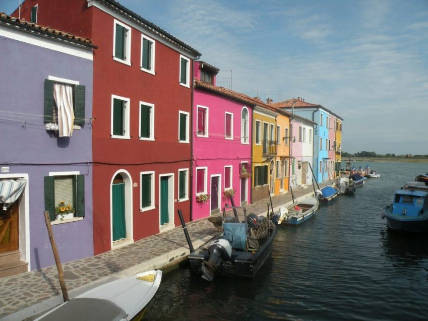Burano's homes were painted in bright colours to guide the fishermen home in the fog, today they are photographed by thousands of day trippers from venice every year