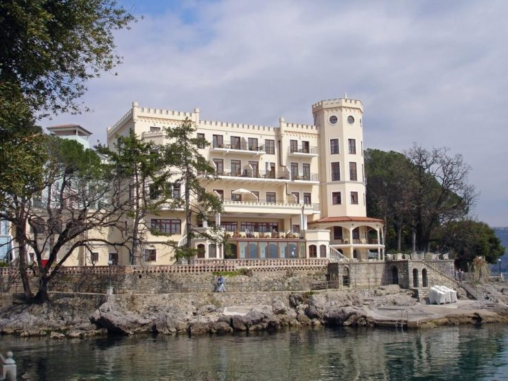 A beautiful hotel in the Belle Epoque style of architecture seen from the Lungomare, or the coastal path of Opatija in Istria