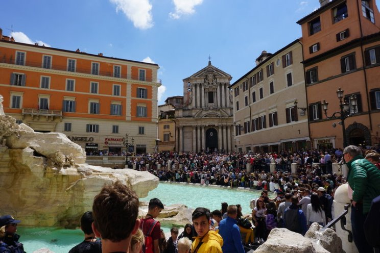 how to avoid the crowds at the trevi fountain - go early in the day