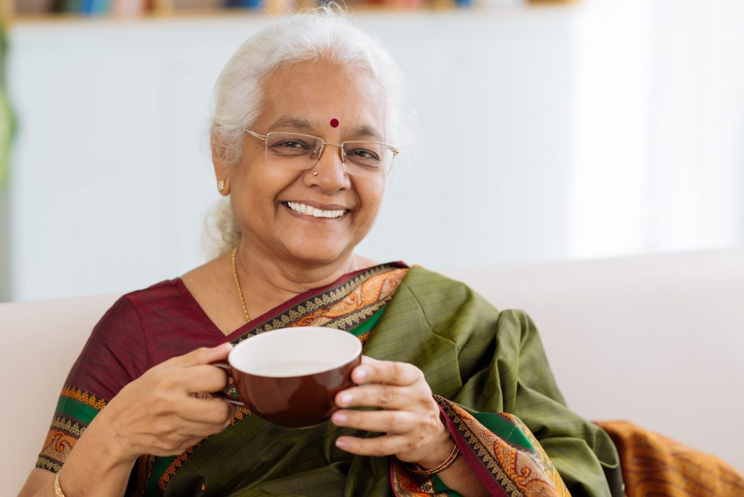 Indian woman cheerful about bladder leaks