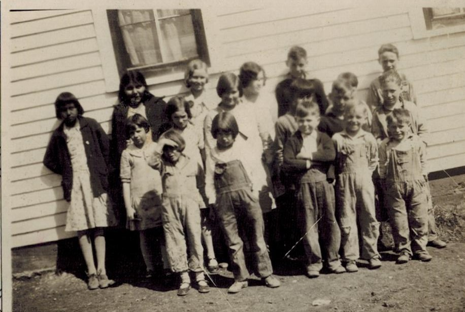 Mother with nieve school kids