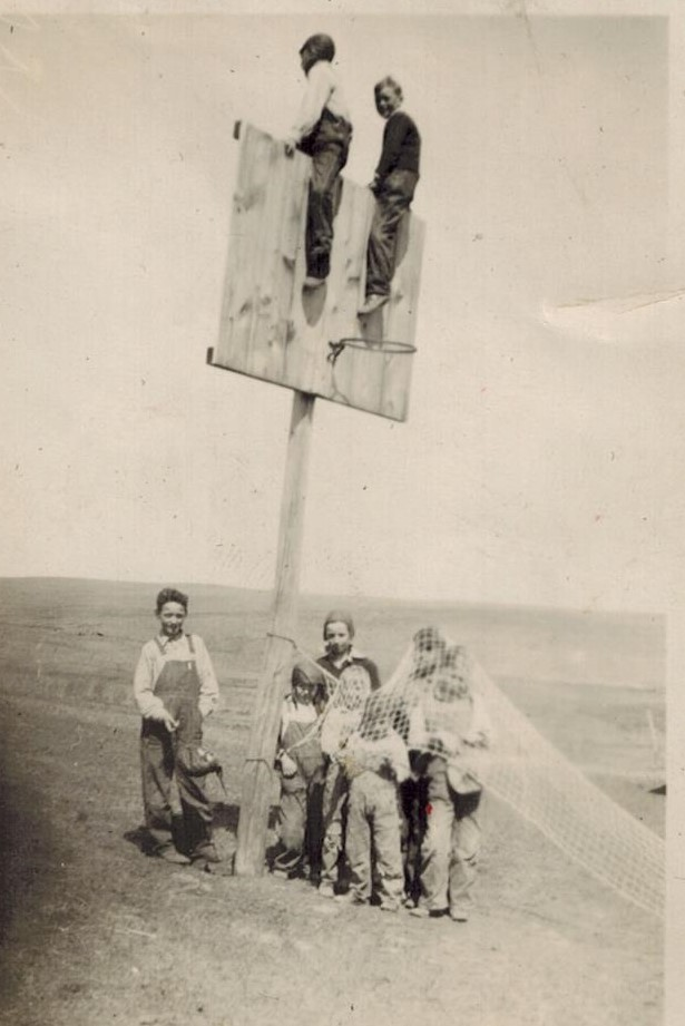 Nieve school Vernon and Everett on poles and Phil on left with cap in hands