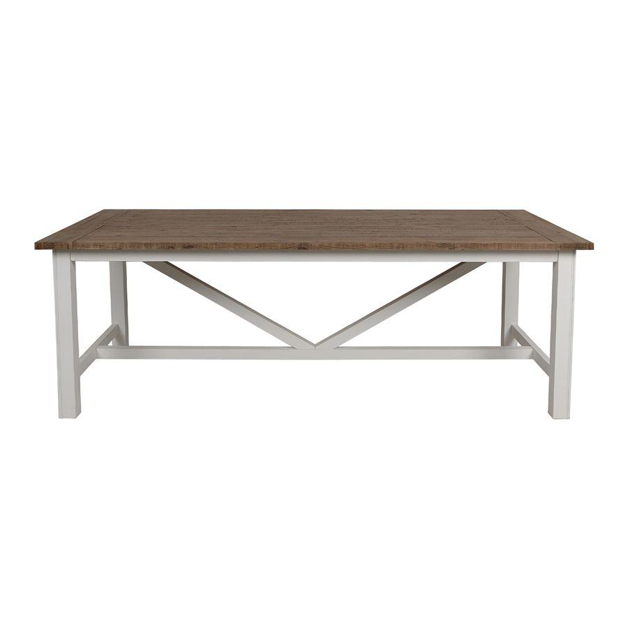 Table de salle à manger en bois brut et pieds blancs de la collection Rivages du magasin interiors
