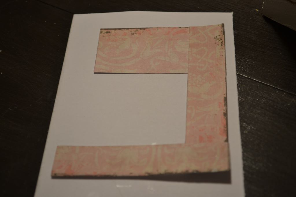 """cut scrapbook paper for the side"""