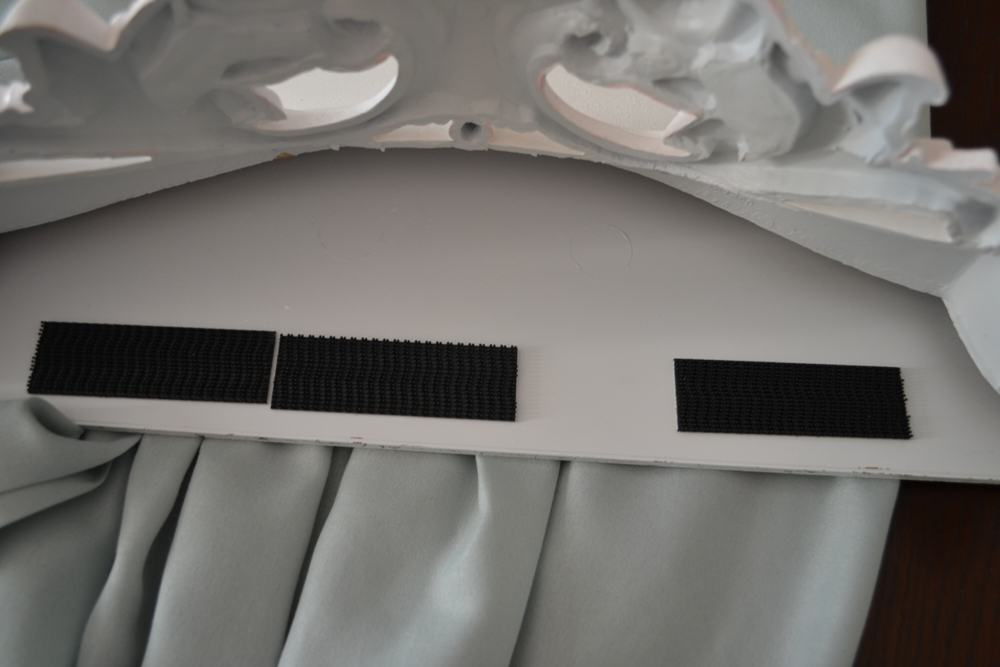 adhere dual lock squares to back of bed crown