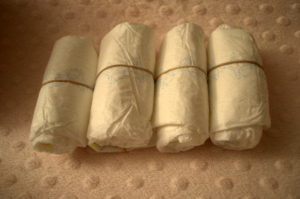 4 diaper rolls for baby's arms and legs