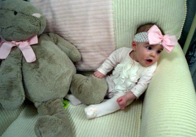 Baby Riley playing in her chair