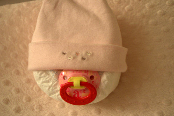 Place hat on Diaper Baby's head
