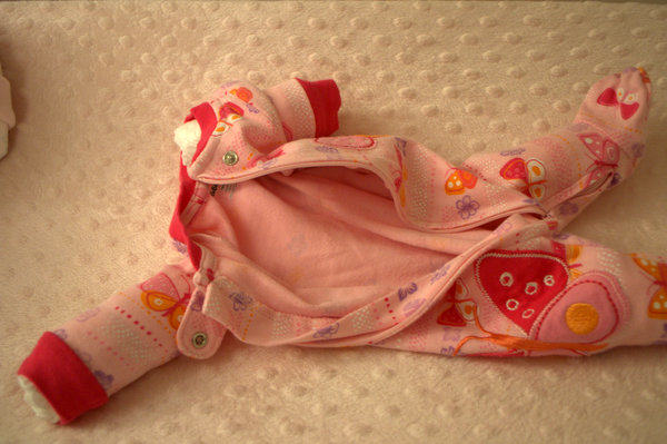 place individual diaper rolls in arm & leg holes