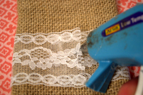 Wrap a piece of lace around bag and glue it in place