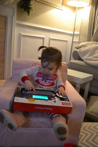 Riley playing with her laptop