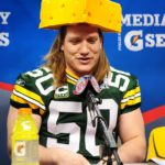 Green Bay Packers linebacker A.J. Hawk wearing Cheesehead hat