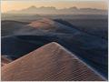 Sunrise on sand dunes near the village of Farahzad, Dasht-e Kavir desert, Iran.