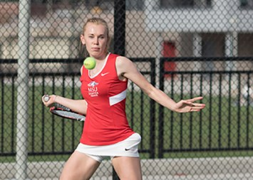 Sophomore Emily Kerr sets a forehand return in her singles match against Weber State's Beauvais, Dominique. Kerr lost in the tie breaker finishing the match 6-3, 4-6, (11-9) at the Regency Athletic Complex on Mar 05. Photo by Brandon N. Sanchez • bsanch36@msudenver.edu