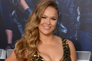 """Ronda Rousey arrives at the premiere of """"The Expendables 3"""" at TCL Chinese Theatre on Monday, Aug. 11, 2014, in Los Angeles. (Photo by Jordan Strauss/Invision/AP)"""