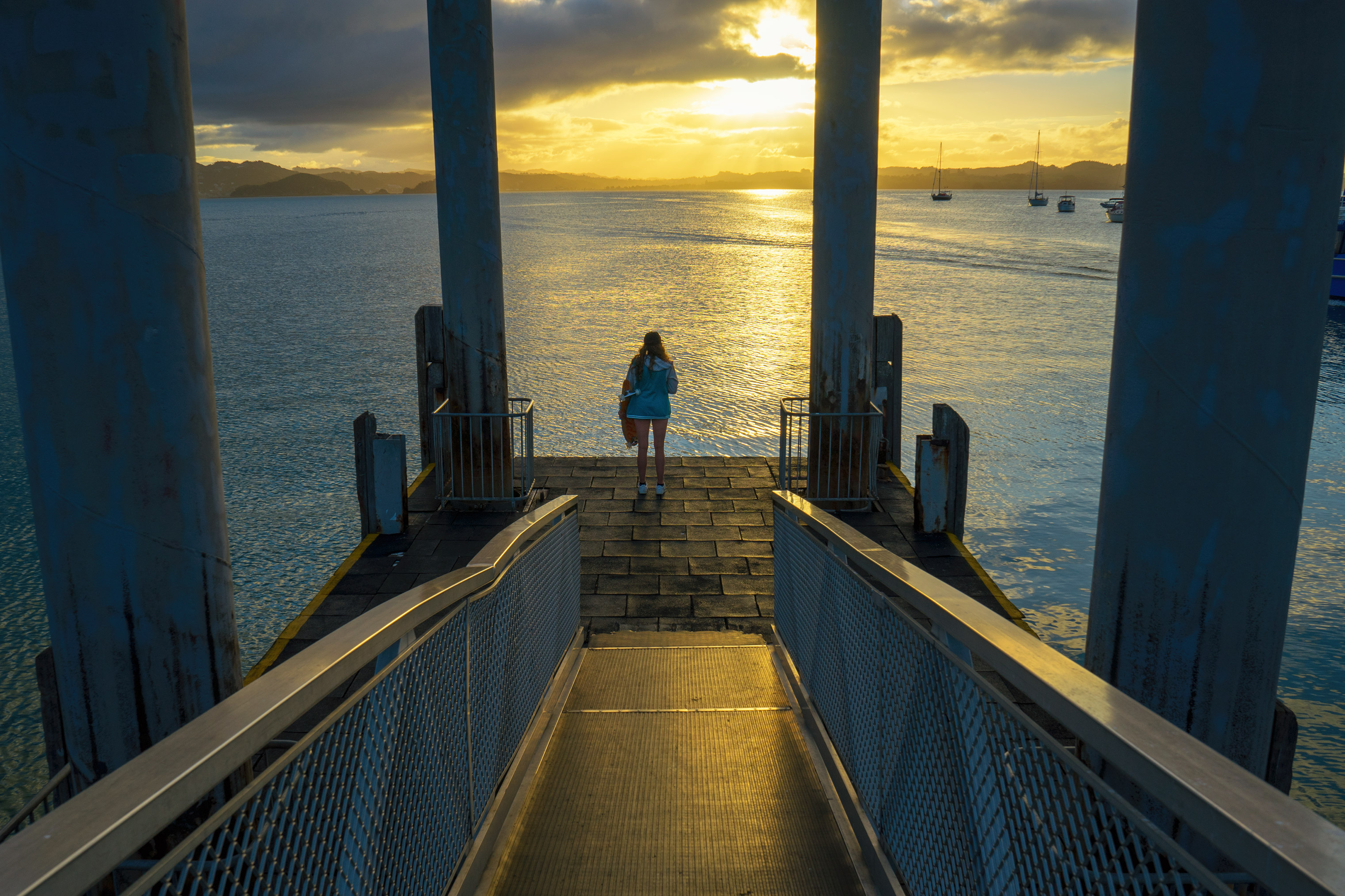 Bay of Islands Russell Pier Sunset With Girl Standing