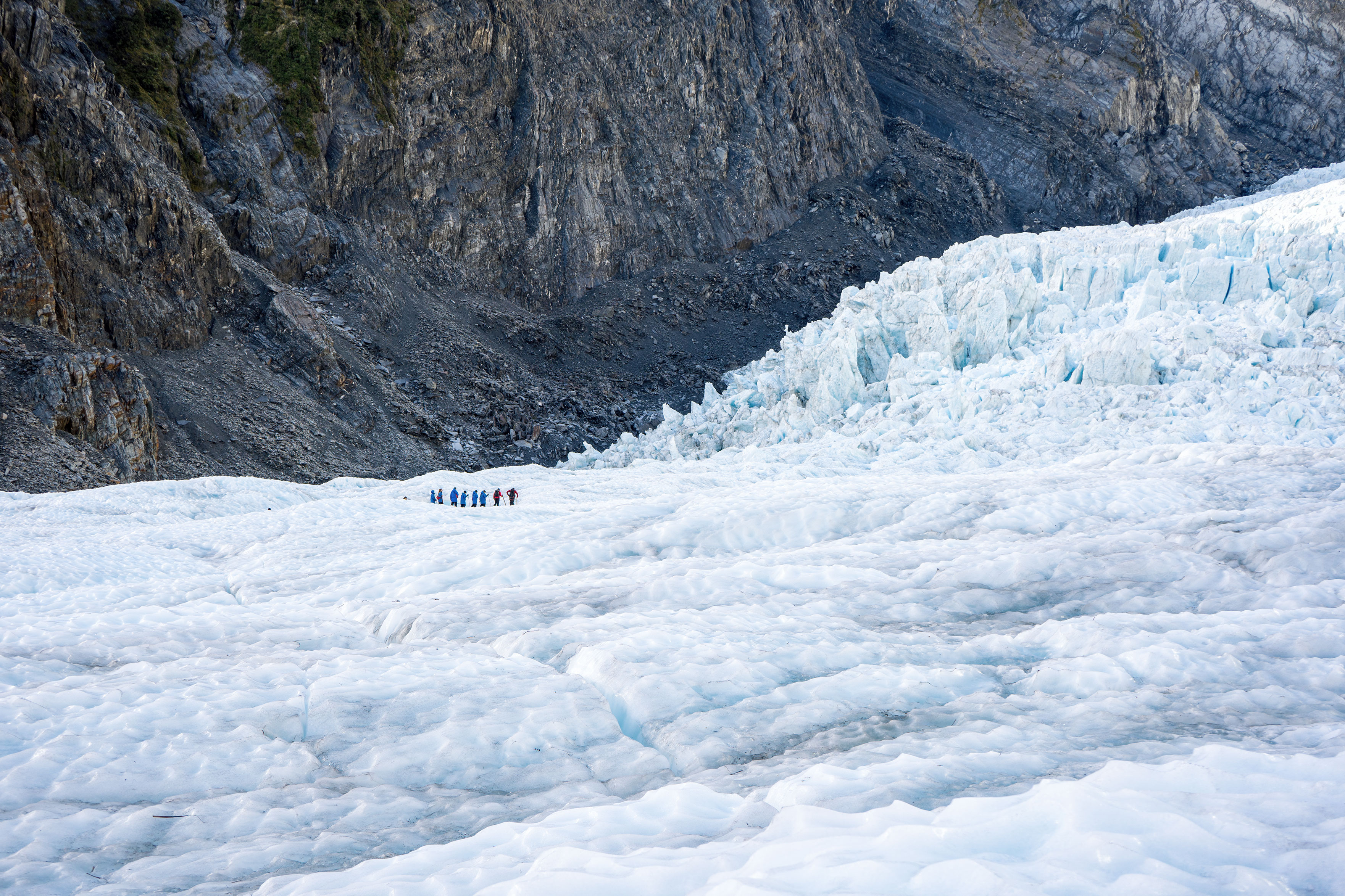 Franz Josef Glacier Heli Hike View Of Glacier Ice And Hikers In The Distance