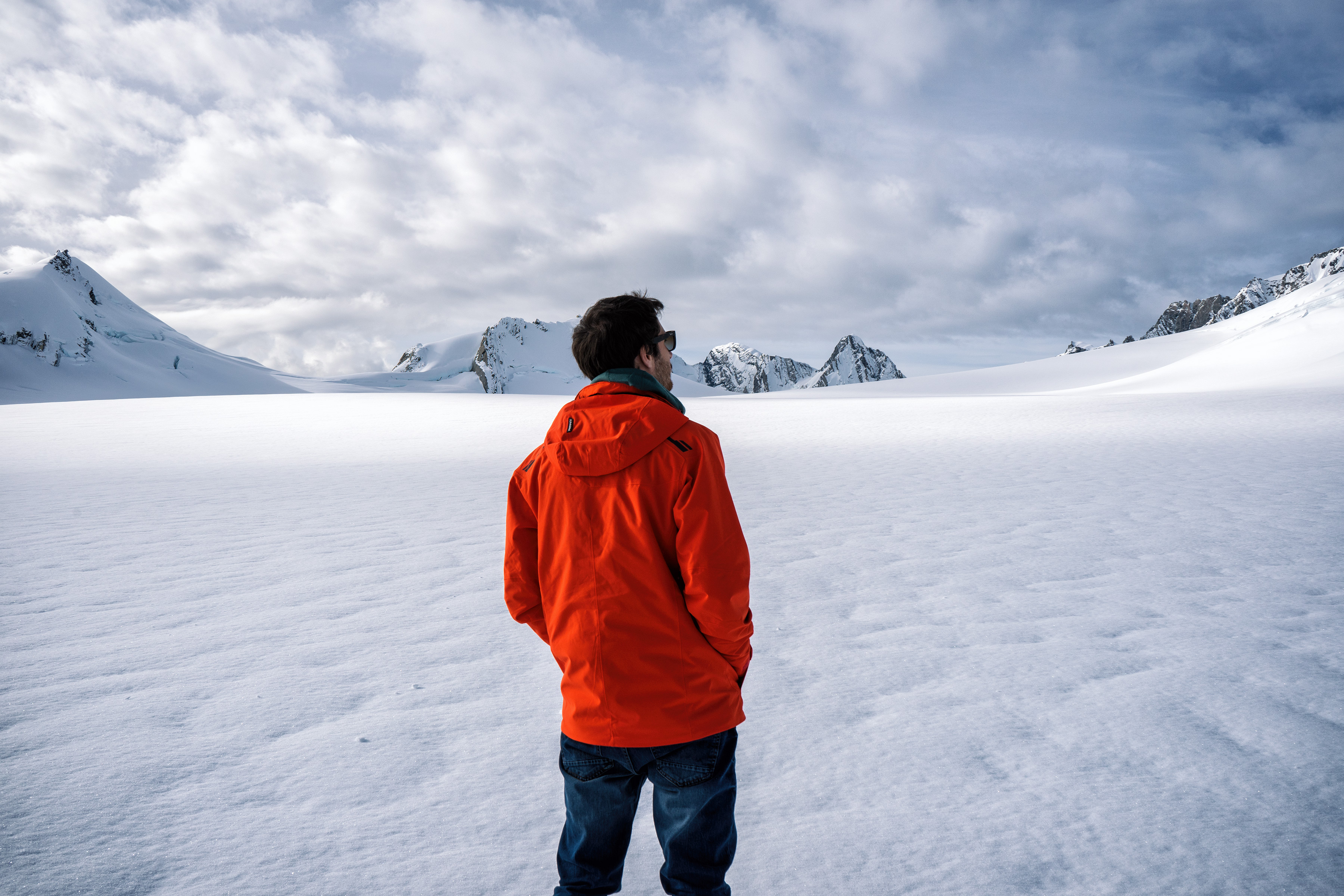 Southern Alps From Above Man Standing On Top Of Franz Josef Glacier Neve